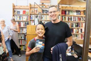 with a fan at Skylight Books